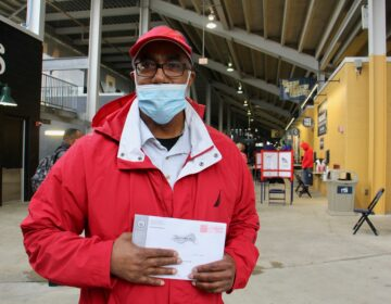 Darryl Turner of Chester, Pa., stops at the pop-up voter service center at Subaru Park to drop off his mail-in ballot. (Emma Lee/WHYY)
