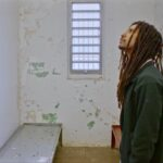 In the new MOVE documentary, '40 Years a Prisoner,' Mike Africa, Jr., visits the prison cell where he was born. (Screenshot from 40 Years a Prisoner)