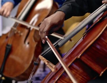 Cellist Ajibola Rivers performs with members of the Philadelphia Orchestra during an online concert staged at Harriett's Bookshop in Fishtown. (Philadelphia Orchestra Facebook)