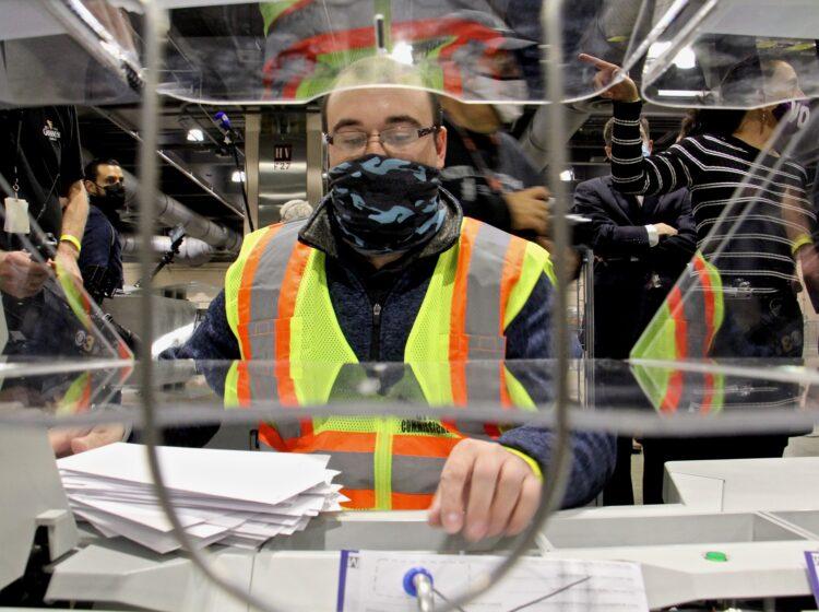 John Hansberry operates an extractor at Philadelphia's ballot counting center