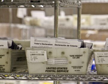 Mail-in ballots are kept in a secure area at the Pennsylvania Convention Center. (Emma Lee/WHYY)