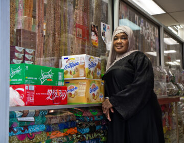 Satte Hoffe at her store in West Philadelphia. She's a Liberian immigrant who said she's voting because she fears a civil war. (Kimberly Paynter/WHYY)
