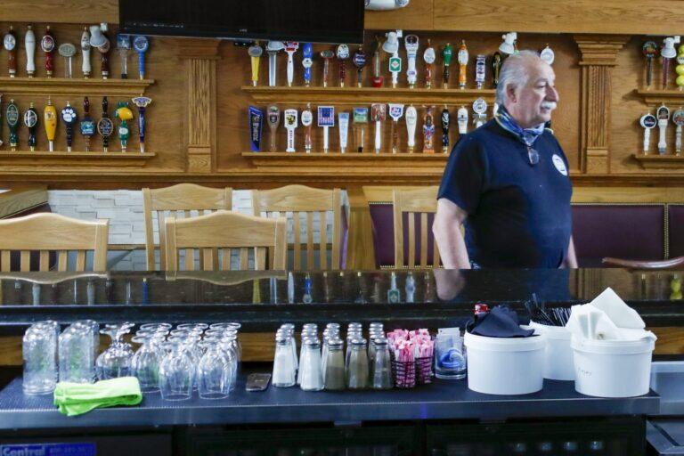 Dominic Lombardo, owner of Domenicos restaurant, looks over the bar area, with the barstools separated, Thursday, June 4, 2020, in Cranberry Township, Pa., the day before patrons were again permitted to dine inside as COVID-19 restrictions loosened in the region. (Keith Srakocic/AP Photo)