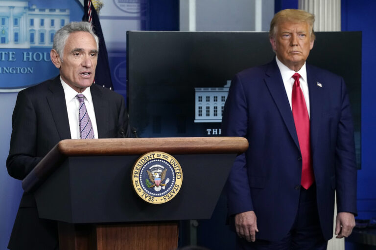 White House coronavirus adviser Dr. Scott Atlas speaks as President Donald Trump listens during a news conference at the White House, Wednesday, Sept. 16, 2020, in Washington. (AP Photo/Evan Vucci)