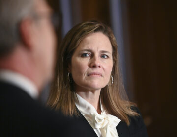 Judge Amy Coney Barrett, U.S. President Donald Trump's nominee to the Supreme Court, meets with U.S. Senator Kevin Cramer (R-ND) on Capitol Hill in Washington, U.S., October 1, 2020. (Erin Scott/Pool via AP)