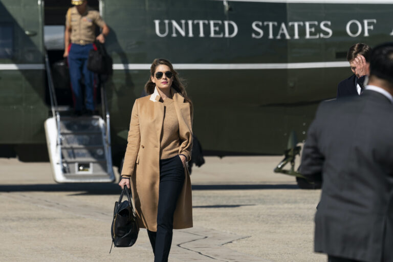 Counselor to the President Hope Hicks walks from Marine One to accompany President Donald Trump aboard Air Force One as he departs Wednesday, Sept. 30, 2020, at Andrews Air Force Base, Md. (AP Photo/Alex Brandon)
