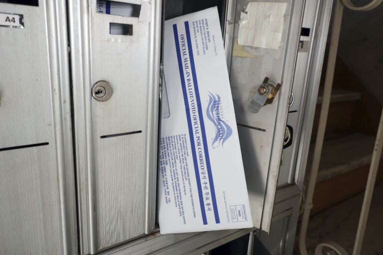 A mail ballot for the presidential election is positioned in the mailbox where it arrived in Rutherford, New Jersey on Friday, October 2, 2020. (AP Photo/Ted Shaffrey)