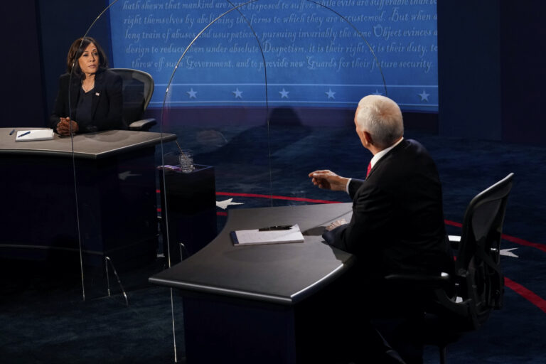 Democratic vice presidential candidate Sen. Kamala Harris, D-Calif., listens as Vice President Mike Pence answers a question during the vice presidential debate Wednesday, Oct. 7, 2020, at Kingsbury Hall on the campus of the University of Utah in Salt Lake City. (AP Photo/Morry Gash, Pool)