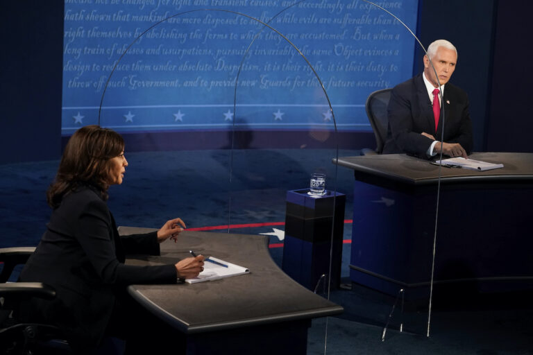 Democratic vice presidential candidate Sen. Kamala Harris, D-Calif., and Vice President Mike Pence answer questions during the vice presidential debate Wednesday, Oct. 7, 2020, at Kingsbury Hall on the campus of the University of Utah in Salt Lake City. (AP Photo/Morry Gash, Pool)