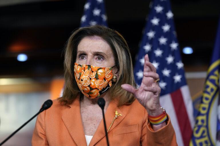 Nancy Pelosi wearing a face mask