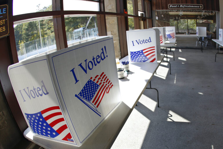 An early election ballot completion area is being prepared at a collection location at the North Park Ice Skating Rink Lodge area, Friday, Oct. 9, 2020, in McCandless, Pa. (AP Photo/Keith Srakocic)