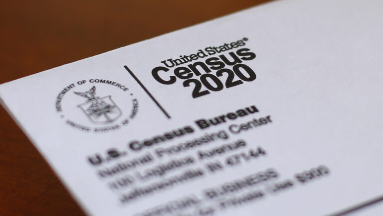 This Sunday, April 5, 2020, file photo shows an envelope containing a 2020 census letter mailed to a U.S. resident in Detroit. (AP Photo/Paul Sancya)