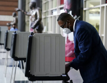 Philadelphia City Council President Darrell Clarke fills out his ballot at the opening of a satellite election office at Temple University's Liacouras Center, Tuesday, Sept. 29, 2020, in Philadelphia. (AP Photo/Matt Slocum)