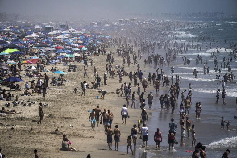 People crowd the beach in Huntington Beach, Calif., Saturday, Sept. 5, 2020. (AP Photo/Jae C. Hong)
