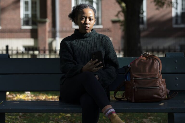 Harvard University graduate student Maya James poses in a park near the university, Wednesday, Oct. 14, 2020, in Cambridge, Mass. (AP Photo/Michael Dwyer)