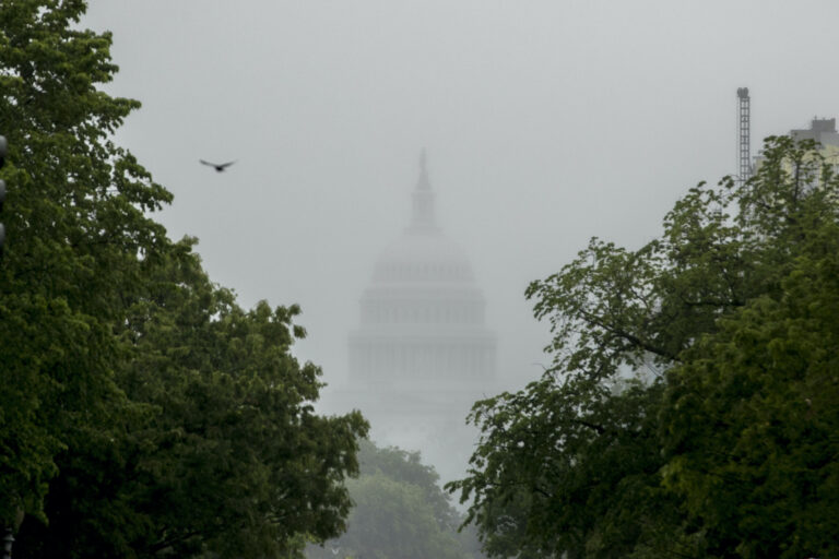 In this May 22, 2020, file photo the Dome of the U.S. Capitol Building is visible through heavy fog in Washington. (AP Photo/Andrew Harnik)