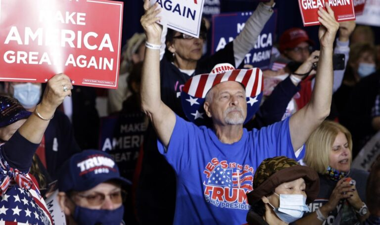 A crowd of people wearing Donald Trump gear attends a rally hosted by Vice President Mike Pence in New Cumberland, Pennsylvania.