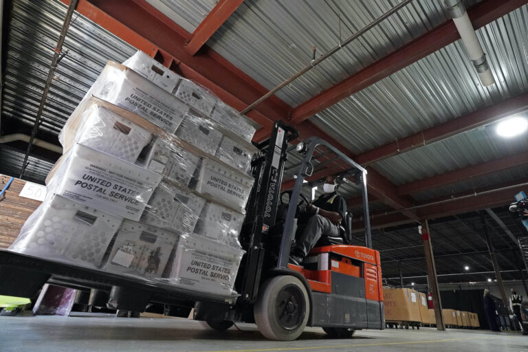 In this Sept. 3, 2020, file photo, a forklift operator loads absentee ballots for mailing at the Wake County Board of Elections as preparations for the upcoming election are ongoing in Raleigh, N.C. (AP Photo/Gerry Broome)