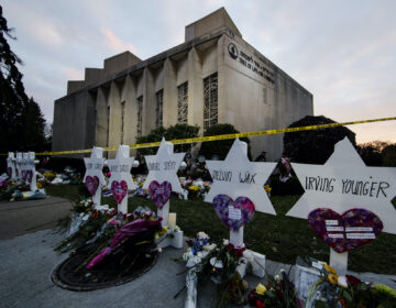In this Oct. 29, 2018 file photo, a makeshift memorial stands outside the Tree of Life Synagogue in the aftermath of a deadly shooting at the in Pittsburgh.  (AP Photo/Matt Rourke)