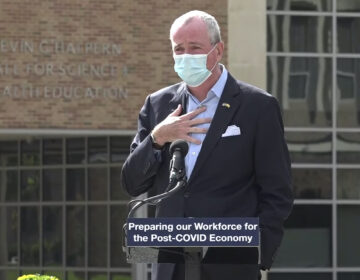 In this Oct. 21, 2020, file photo, taken from video provided by the New Jersey Governor's Office, New Jerrsey Gov. Phil Murphy tells attendees at an event in Blackwood, N.J., that he must leave the event to quarantine after just finding out that he'd been in contact with someone who had tested positive for COVID-19.  (New Jersey Office of the Governor via AP)