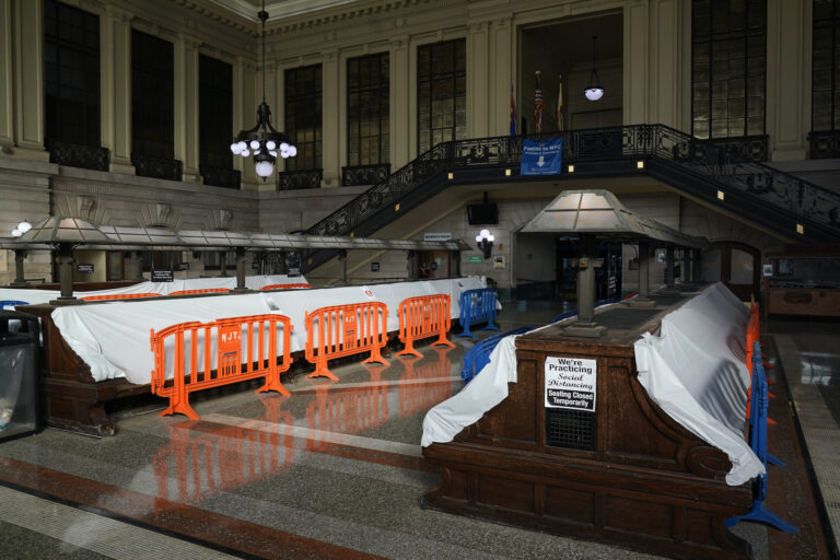 Tarps and fences block the seating area in the Hoboken Terminal waiting room in Hoboken, N.J., Tuesday, Oct. 27, 2020. (AP Photo/Seth Wenig)