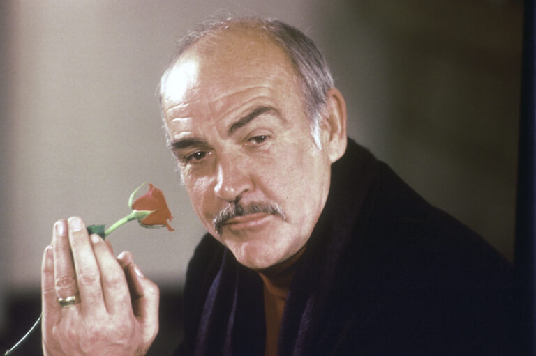 Actor Sean Connery holds a rose in his hand as he talks about his new movie