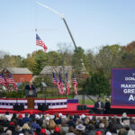 President Donald Trump speaks at a campaign rally at Keith House, Washington's Headquarters, Saturday, Oct. 31, 2020, in Newtown, Pa. (AP Photo/Chris Szagola)