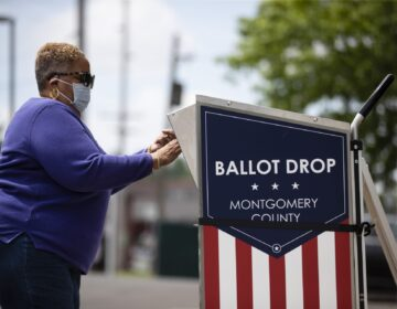 A voter drops off their mail-in ballot prior to the primary election, in Willow Grove, Pa., Wednesday, May 27, 2020. (Matt Rourke/AP Photo)