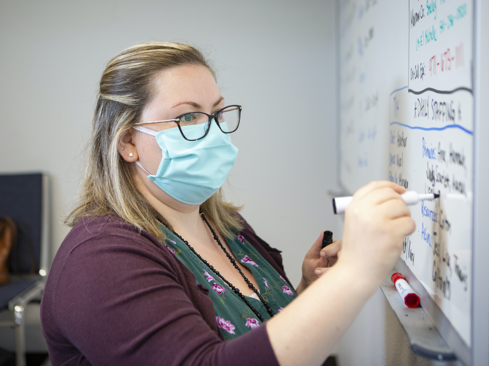 Heather Griggs, a registered nurse and operations chief of the Umatilla County Public Health Department contact tracing center in Pendleton, Ore., updates a list of job assignments on Tuesday, July 14, 2020.