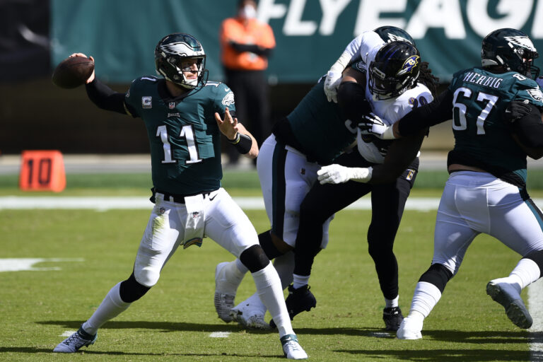 Carson Wentz passes during the first half of the Eagles-Ravens game