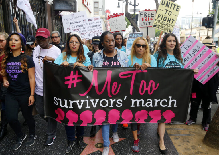 Tarana Burke marches with others at the #MeToo March in the Hollywood section of Los Angeles in 2017