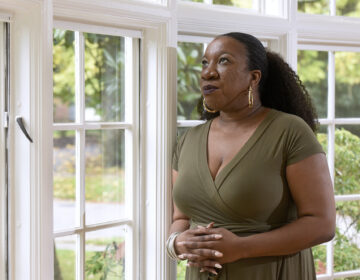 Tarana Burke stands in her home in Baltimore