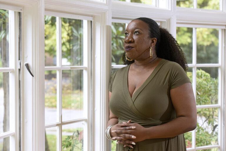 Tarana Burke stands in her home in Baltimore