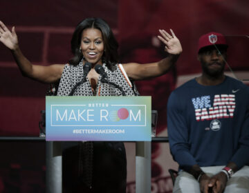 Former first lady Michelle Obama speaks at the University of Akron as NBA star LeBron James listens
