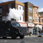 Police deploy tear gas to disperse a crowd during a protest in Philadelphia over the killing of George Floyd