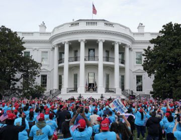 President Donald Trump speaks from the Blue Room Balcony of the White House to a crowd of supporters, Saturday, Oct. 10, 2020, in Washington.