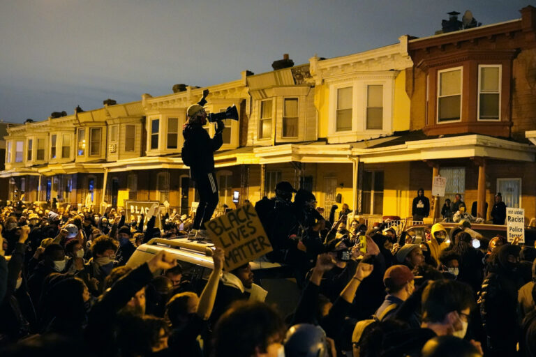 Protesters confront police during a march Tuesday, Oct. 27 in West Philadelphia.