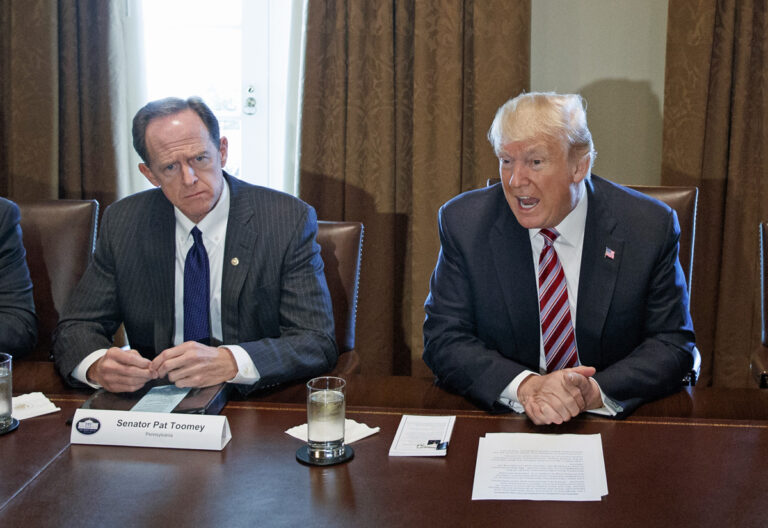 Sen. Pat Toomey (left) sits beside President Donald Trump during a meeting with lawmakers about trade policy in the Cabinet Room of the White House, Tuesday, Feb. 13, 2018, in Washington. (AP Photo/Evan Vucci)