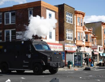 Police deploy tear gas to disperse a crowd during a protest Sunday, May 31, 2020, in Philadelphia over the death of George Floyd. Floyd died May 25 after he was pinned at the neck by a Minneapolis police officer. (AP Photo/Matt Rourke)