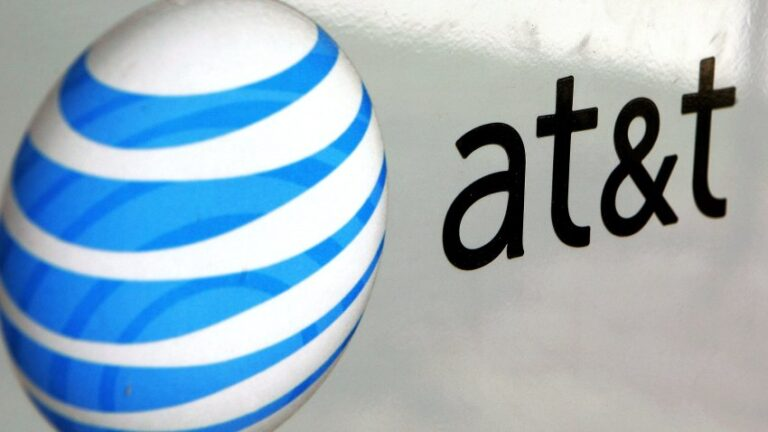 An AT&T logo is displayed on an AT&T truck