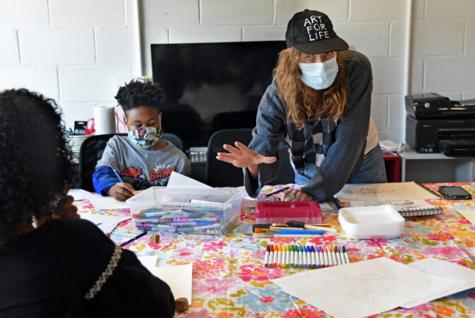South Jersey artist Marcy Morris teaches art; at left is student Malik Lance, 9