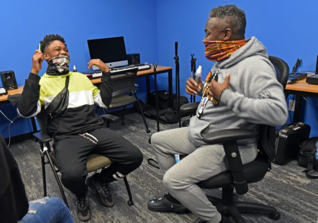 Arthur Leo Taylor makes student Ison Keith, 14, laugh during drama class