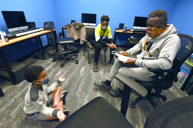 Drama teacher Arthur Leo Taylor works with students Nash Daniels, 8 (left) and Ison Keith, 14