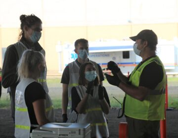 Medical workers at a COVID-19 testing site in McKeesport, Pa. (Katie Blackley/WESA)