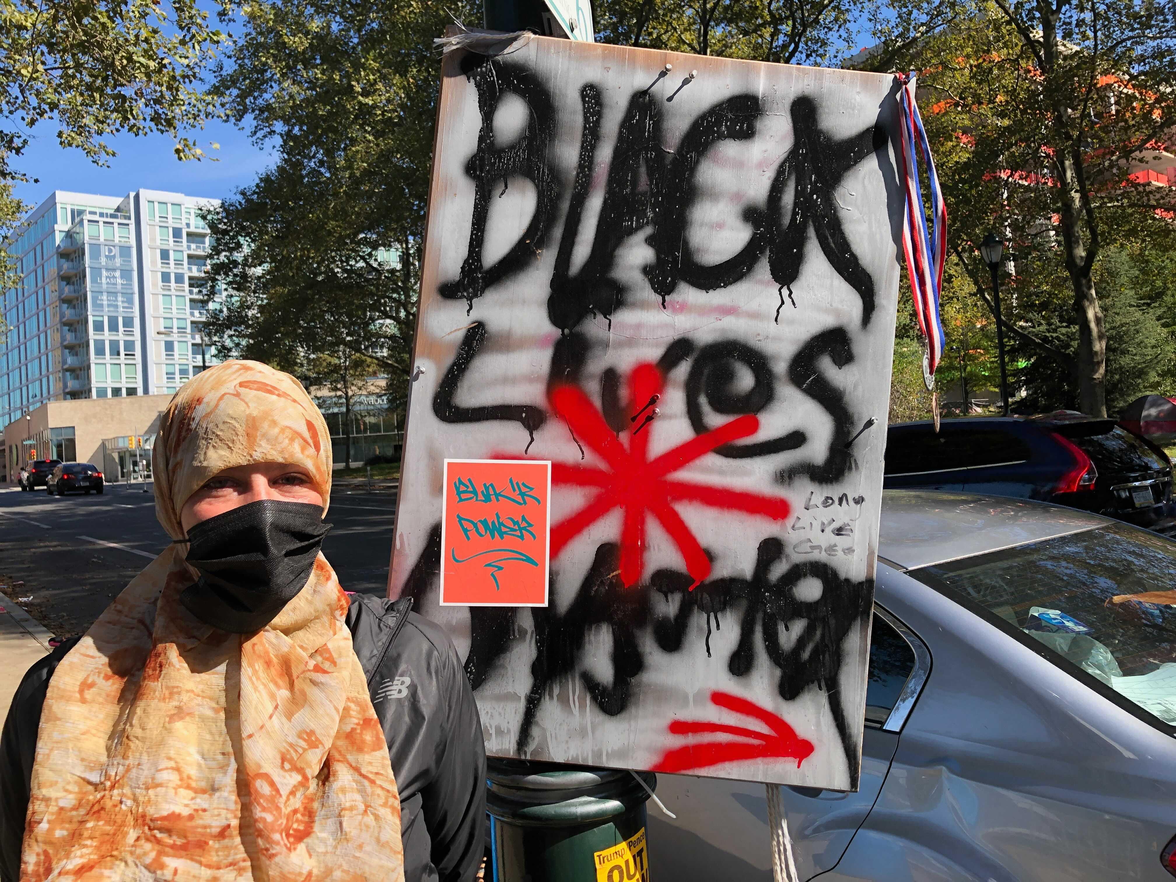 Housing activist Jenn Bennetch with Black Lives Matter sign