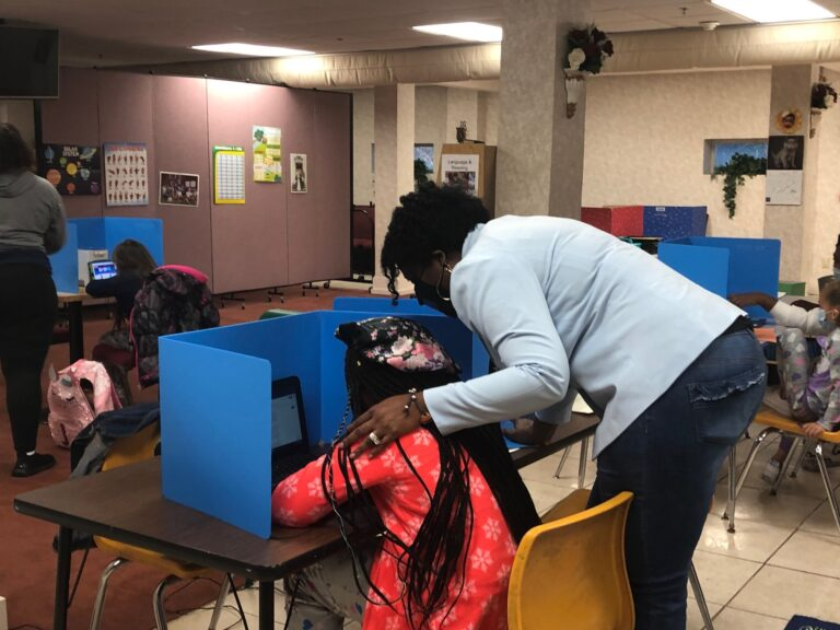 A Leap of Faith owner Melanie Thomas-Price works with fifth-grader Cameryn Jones. (Cris Barrish/WHYY)