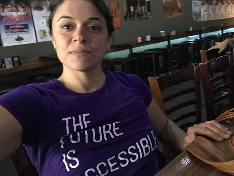 Woman wearing a shirt that says 'The future is accessible'