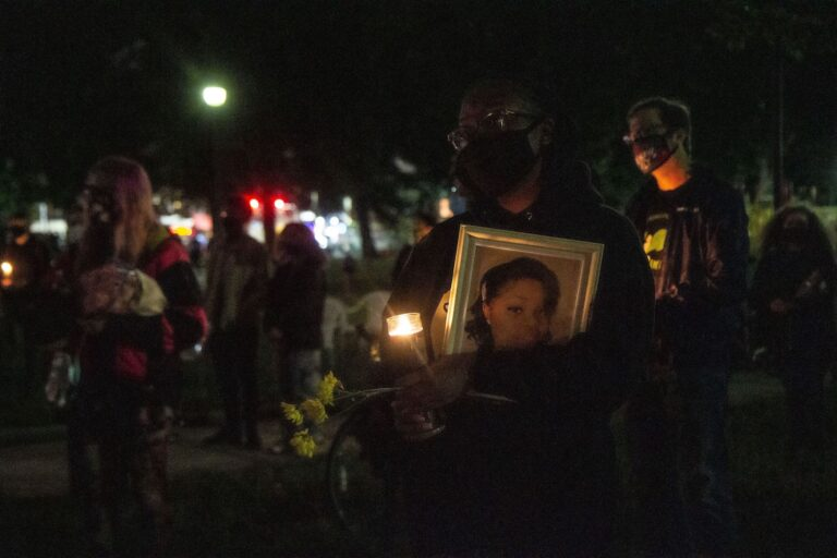 People gathered at Malcolm X Park in West Philadelphia to hold a vigil for Breonna Taylor on Oct. 1, 2020. (Kimberly Paynter/WHYY)