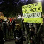 A crowd gathers at Malcolm X Park to protest the police shooting of Walter Wallace Jr. (Emma Lee/WHYY)