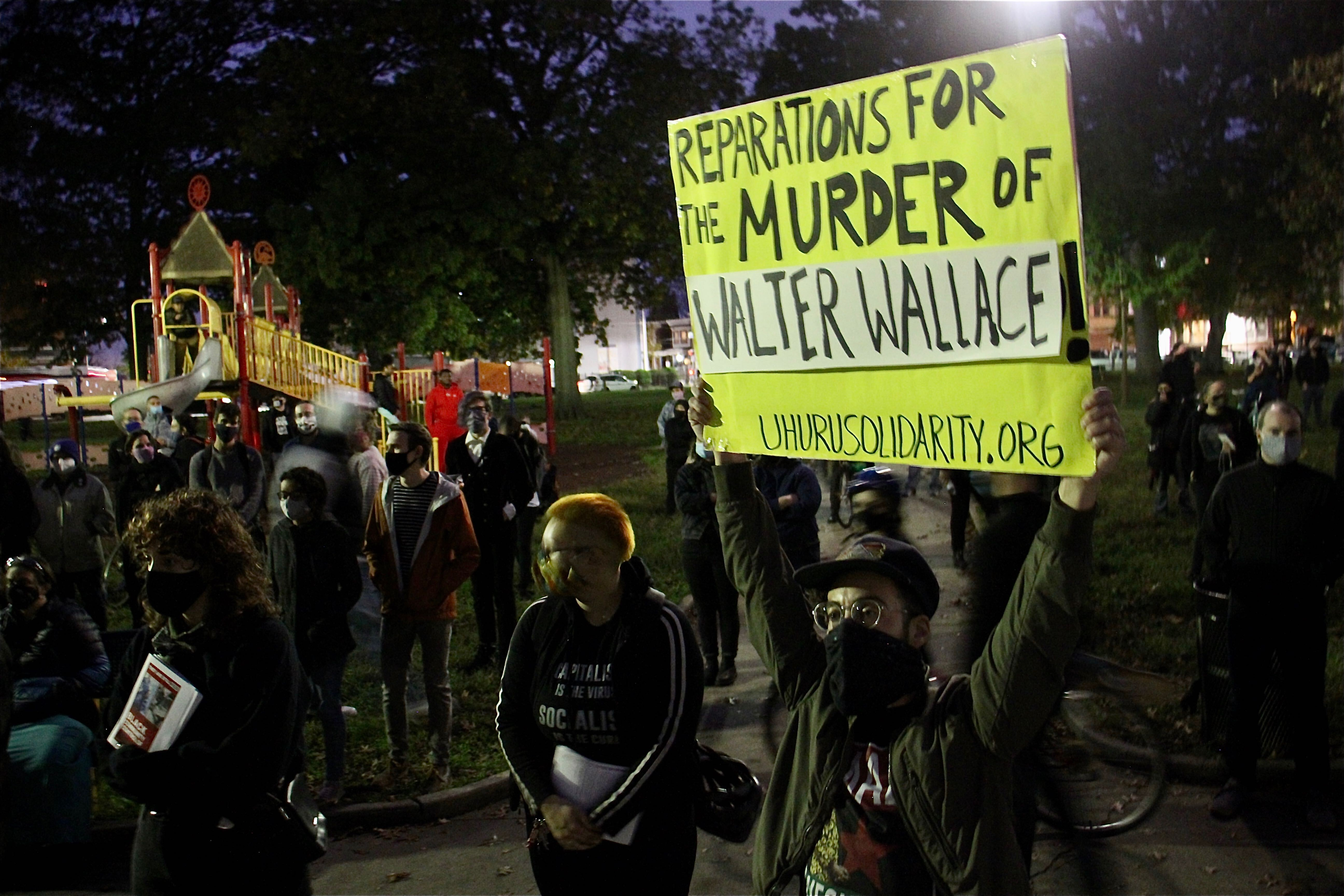 A crowd gathers at Malcolm X Park to protest the police shooting of Walter Wallace Jr.